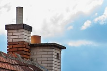 Old Brick Chimney On The Roof....