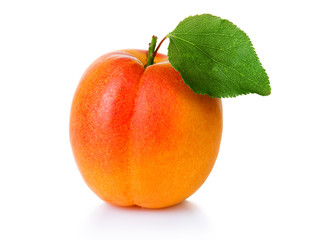 Ripe apricot fruit with green leaf isolate on white