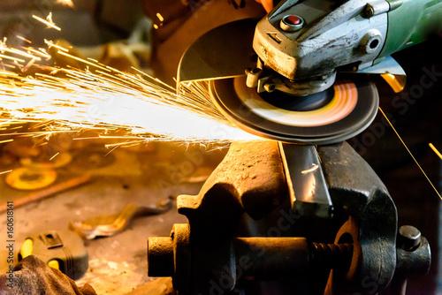 Fotografie, Obraz  Cutting metal grinding machine, spark.