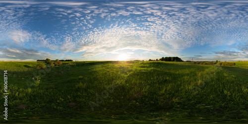 Fotografia  Sunset on meadow spherical 360 degree panorama