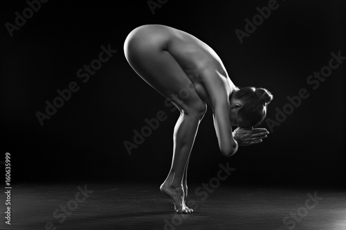 Nude woman making exercise for relaxation Fototapeta