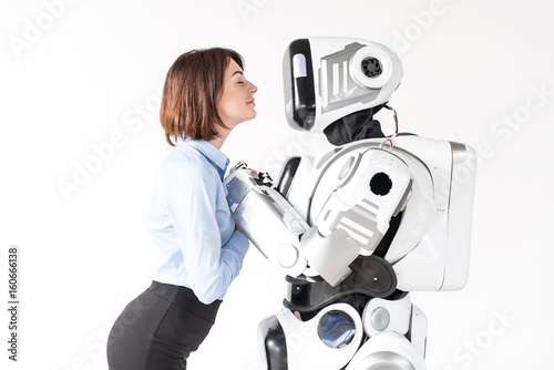 Fotografia, Obraz  Attractive girl is expressing love while holding hands of cyborg
