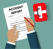 Businessman Completing Accident Report Document Beside First Aid Kit - Health And Safety Concept