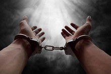 Hands Of Prisoner In Handcuffs
