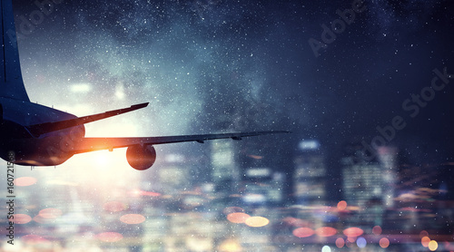 Fotomural Airliner in night sky