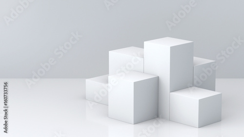 Photographie White cube boxes with white blank wall background for display