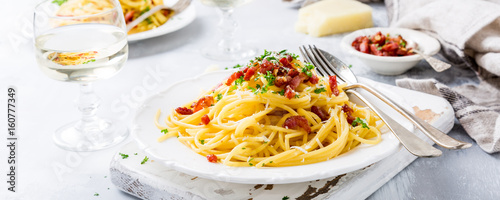 Fotografie, Obraz  Italian pasta spaghetti Carbonara with fried bacon, parmesan cheese and parsley on white plate