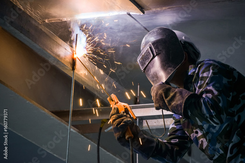 Fotografie, Obraz  Arc welding of a steel in construction site