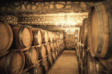 Fototapeta Vintage winery cellar with wine barrels