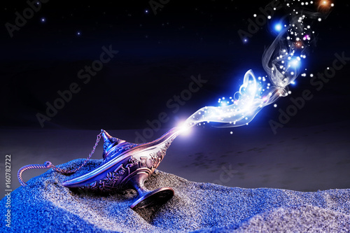 Stampa su Tela magical aladdin lamp with smoke coming out in a night resting on the dunes of a desert