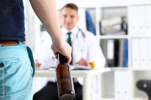 Poster de jardin Bar Alcoholic hold in hand empty bottle at doctor reception