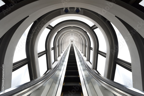 Obraz Futuristic tunnel and escalator of steel and metal, interior view. Futuristic background, business concept - fototapety do salonu