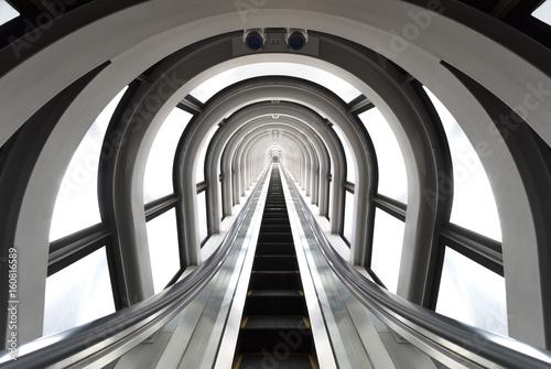 Obraz Futuristic tunnel and escalator of steel and metal, interior view. Futuristic background, business concept - fototapety do salonu