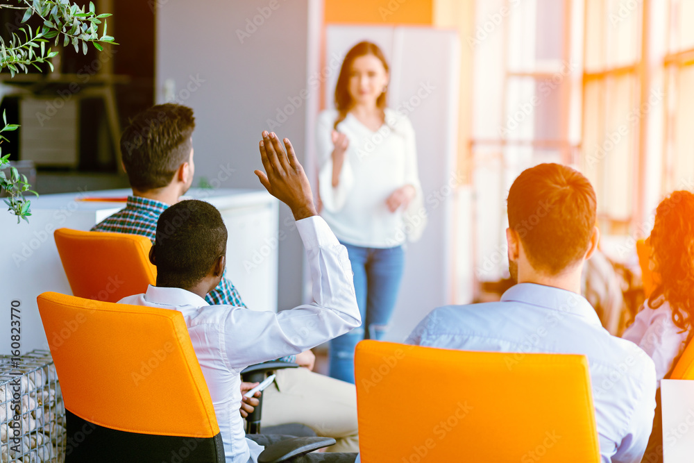 Fototapeta African american Business people Raising there Hand Up at a Conference to answer a question