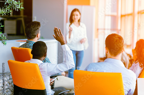 African american Business people Raising there Hand Up at a Conference to answer Wallpaper Mural