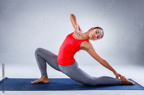 Yoga Concept Pretty Sporty Indian Woman Smiling In Doing Yoga On Concrete Background Buy This Stock Photo And Explore Similar Images At Adobe Stock Adobe Stock