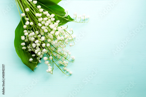 Wall Murals Lily of the valley Bouquet of fresh white lilies of the valley in a wooden window still. Top view