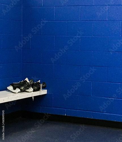 Hockey skates in locker room Canvas Print