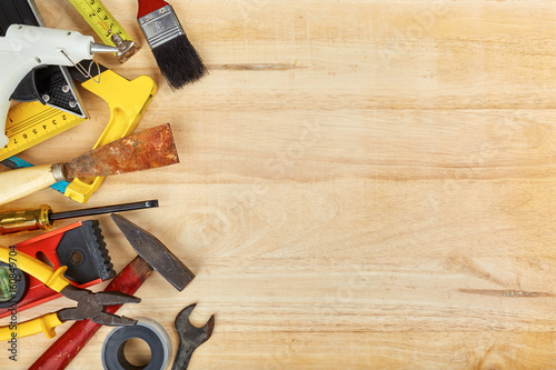 Fotografía  Hand tools on wooden background with copy space, Top view