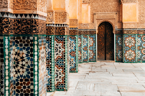 Poster Maroc colorful ornamental tiles at moroccan courtyard
