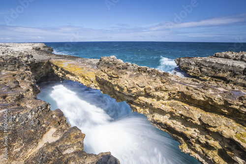 Waves in the natural arches of limestone carved by sea Devil's Bridge Caribbean Antigua and Barbuda Leeward Islands West Indies