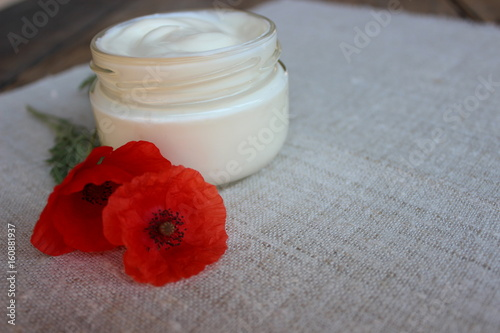 Cosmetic Cream With Poppy Flower Buy This Stock Photo And Explore