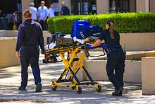 Paramedics Pushing A Gurny Loa...