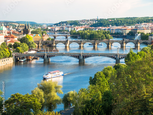 Poster Praag view over vltava river and its bridges with charles bridge in background