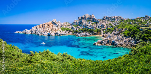 Tuinposter Kust Bizarre granite rock and azure bay in Capo Testa, Sardinia, Italy