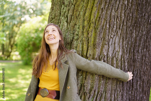 Fotografie, Obraz  Happy young woman standing daydreaming