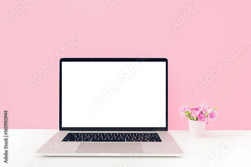 Fotografie, Obraz  Laptop with white blank screen and flowers in vase on table on pink background