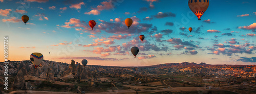 Poster de jardin Beige Sunrise and flying hot air balloons over the valley Cappadocia, Turkey.
