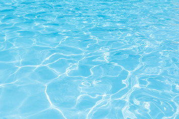 Naklejka na ściany i meble Blue water surface in swimming pool for background