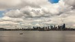 Time lapse movie of moving white clouds and blue sky over Seattle downtown city skyline and Puget Sound 4k uhd time lapse