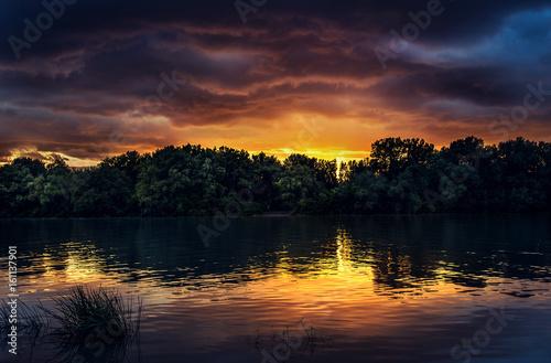 Fototapeta Beauty sunset near the river.