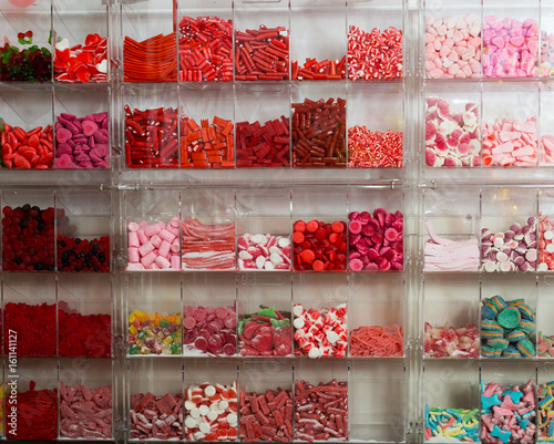 Photo candys and sweets different colors in supermarket