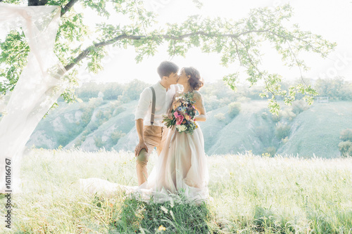 wedding couple on  nature.  bride and groom hugging at  wedding. Fotobehang