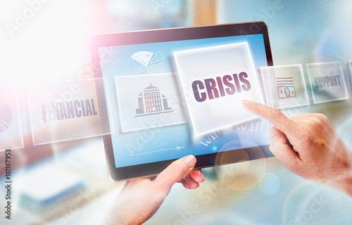 Photo A businesswoman selecting a Crisis business concept on a futuristic portable computer screen