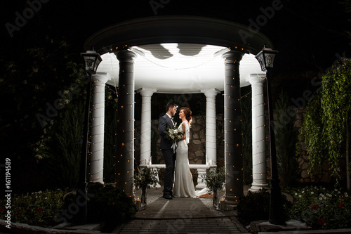 Poster Feeën en elfen Night wedding ceremony in a beautiful arch and lights