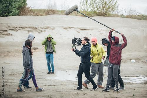 Fotografia Behind the scene. Film crew filming movie scene outdoor