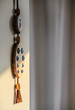 Traditional evil eye beads on shamanic wooden charm hanging on the wall