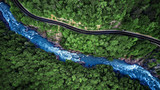Fototapeta Do pokoju - Aerial view of Mountain river and road. Mountain gorge