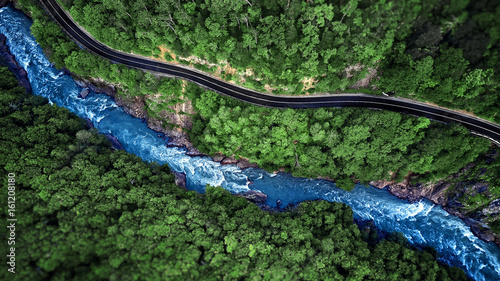 Poster Rivière de la forêt Aerial view of Mountain river and road. Mountain gorge
