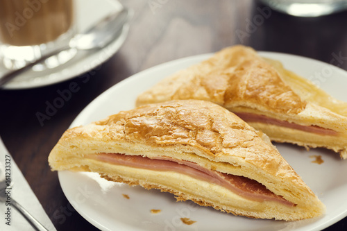Fotografie, Obraz  Savory Ham and Cheese Sandwich Pastry in European Cafe