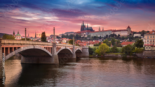 Poster Prague Prague at sunset. Image of Prague, capital city of Czech Republic, during dramatic sunset.