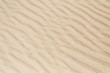 Sandy waves, sand on the beach or desert texture pattern