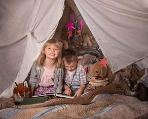 girl and boy in a fort