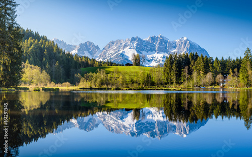 Garden Poster Blue jeans Idyllic alpine scenery, snowy mountains mirroring in a small lake, Kitzbühel, Tyrol, Austria