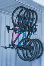 Bicycles Hanging On Rack Under...