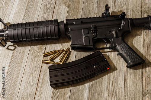 Fotografia, Obraz  AR-15 styled rifle on a wooden table